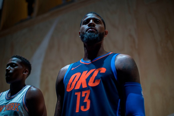 18c4a7c99ac Paul George Oklahoma City Thunder Paul George wears one of the new league  jerseys representing a new partnership between ...