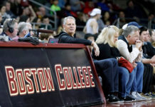 Danny Ainge courtside at a Boston College game.