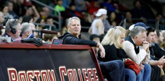 Danny Ainge courtside at a Boston College game.