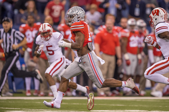 December 6, 2014: Ohio State Buckeyes running back Ezekiel Elliott (15) runs for a long gain after he loses his shoe during the NCAA Big 10 Championship football game between the Wisconsin Badgers and Ohio State Buckeyes at Lucas Oil Stadium in Indianapolis, IN. (Photo by Zach Bolinger/Icon Sportswire/Corbis via Getty Images)