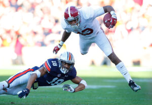 AUBURN, AL - NOVEMBER 28:  Carlton Davis #18 of the Auburn Tigers tackles ArDarius Stewart #13 of the Alabama Crimson Tide at Jordan Hare Stadium on November 28, 2015 in Auburn, Alabama.  (Photo by Kevin C. Cox/Getty Images)