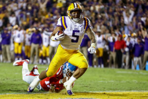 October 22, 2016: LSU Tigers running back Derrius Guice (5) runs through Ole Miss wide receiver Derrick Jones (19) to score a touchdown during the game between the Ole Miss Rebels and the LSU Tigers at Tiger Stadium in Baton Rouge, LA. (Photo by Stephen Lew/Icon Sportswire via Getty Images)