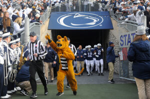 STATE COLLEGE, PA - NOVEMBER 26: The Penn State Nittany Lion mascot leads the team onto the field. The Penn State Nittany Lions defeated the Michigan State Spartans 45-12 to win the Big Ten East Division on November 26, 2016 at Beaver Stadium in State College, PA. (Photo by Randy Litzinger/Icon Sportswire via Getty Images)