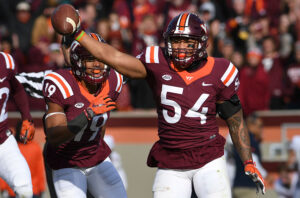 BLACKSBURG, VA - NOVEMBER 26: Linebacker Andrew Motuapuaka #54 of the Virginia Tech Hokies reacts following his interception against the Virginia Cavaliers in the second half at Lane Stadium on November 26, 2016 in Blacksburg, Virginia. Virginia Tech defeated Virginia 52-10. (Photo by Michael Shroyer/Getty Images)