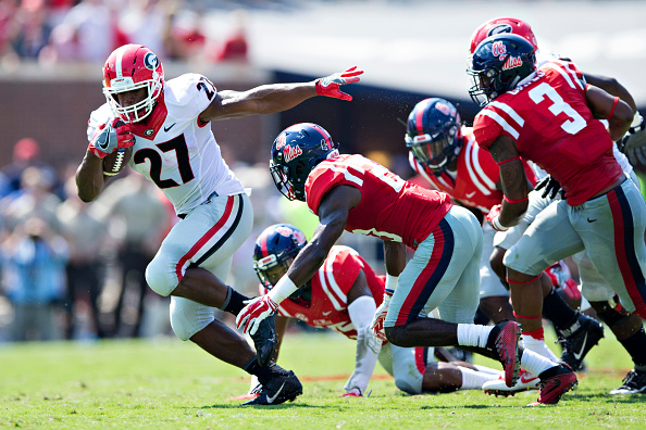 Nick Chubb  27 of the Georgia Bulldogs runs the ball and is pursued by the  defense of the Mississippi Rebels at Vaught-Hemingway Stadium on September  24 cbc86ffca
