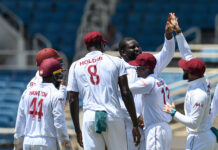 The West Indies Cricket Players celebrate a wicket 2019