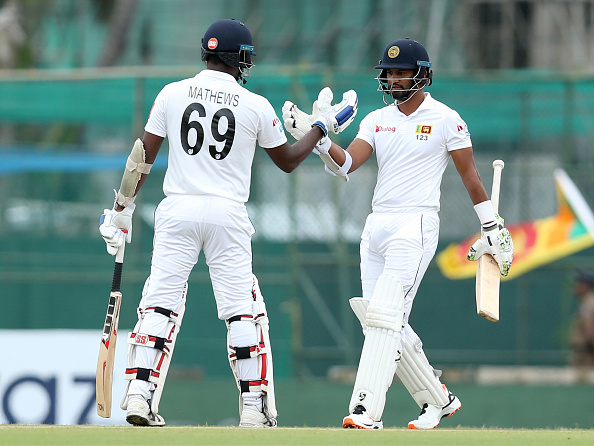 Angelo Mathews celebrates scoring a half-century vs New Zealand in 2019