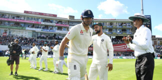 Alastair Cook bats while playing Cricket in India at the Oval 2018. Virat Kohli gives and the Indian Cricket Team give him the guard of honour.