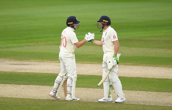 Ollie Pope and Jos Buttler helped England dominate the first day in the third test at Old Trafford scoring 258-4 against the West Indies