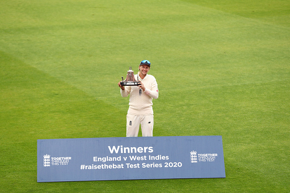 Joe Root the England captain holds the Wisden Trophy