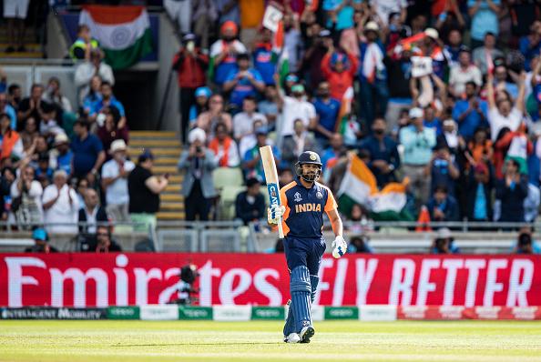 Rohit Sharma celebrates scoring a century vs England at the 2019 Cricket World Cup