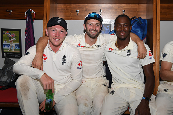 Jofra Archer and Mark Wood celebrate after winning the test series 3-1 in South Africa in 2019/20