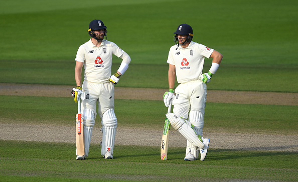 Chris Woakes and Jos Buttler helped guide England home on the fourth day of the first test match.