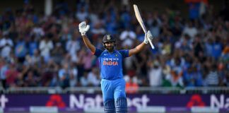 Rohit Sharma celebrates scoring a century versus England in an ODI in 2018