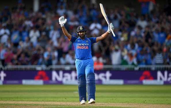 Rohit Sharma celebrates scoring a century versus England in an ODI in 2018