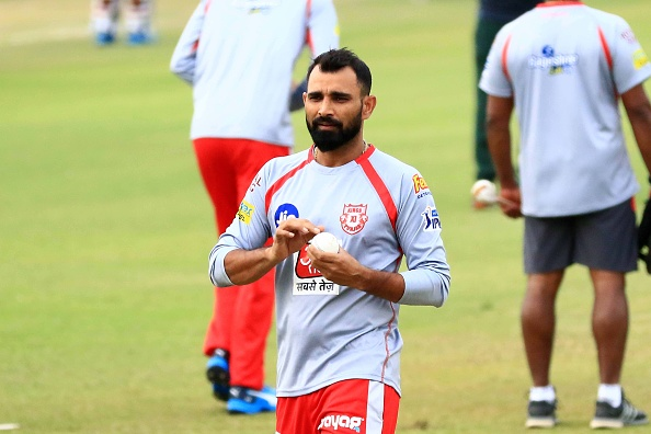 Mohammad Shami practices bowling in training.