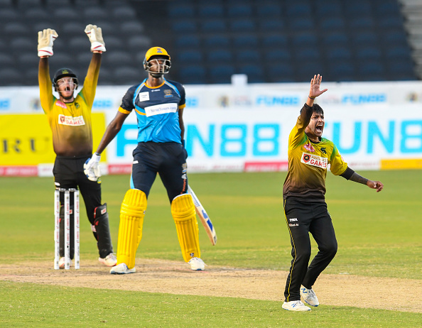 Sandeep Lamichhane picks up a wicket during CPL 2020