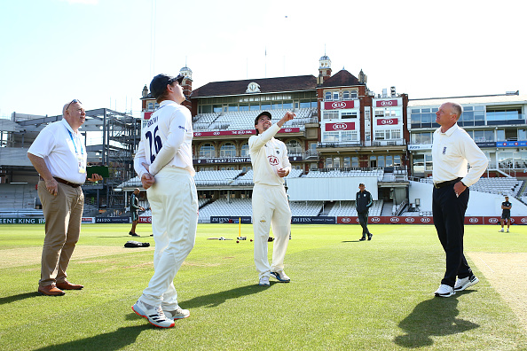 Rory Burns and Ben Brown toss the coin in the game between Sussex CCC and Surrey CCC