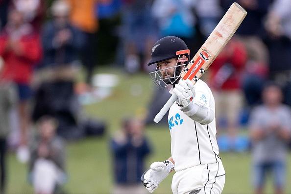 Kane Williamson raises his bat after scoring 200 vs Pakistan in test.
