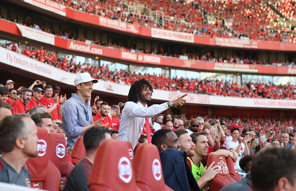 Mesut Ozil and Elneny watch from stands