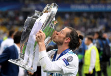 Gareth Bale holding the Champion's League trophy for the fourth time.