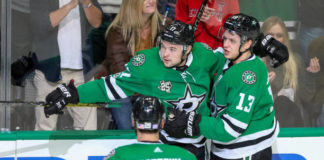 Devin Shore celebrates a goal against the New York Islanders with Matias Janmark