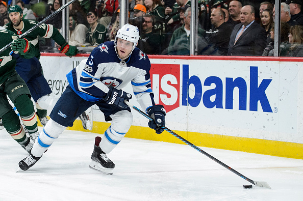 Laine moves into tie for scoring lead as Jets topple Stars