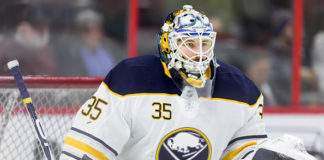 Linus Ullmark looks onward during a game.