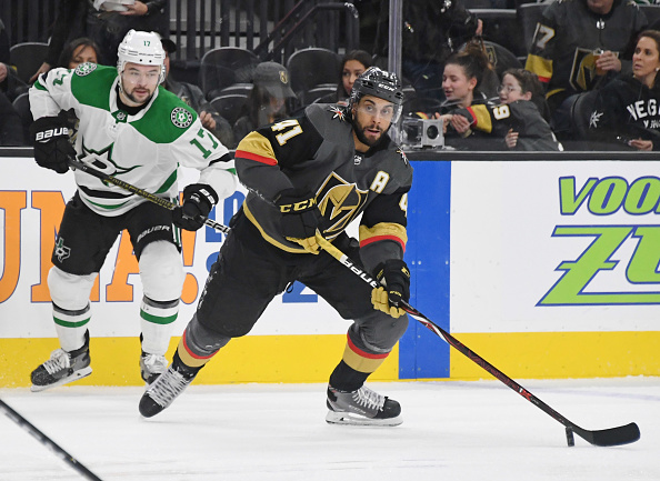 Pierre-Edouard Bellemare carries the puck.