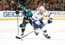 Ryan Callahan skates past Adam Henrique of the Anaheim Ducks.