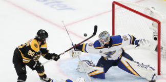 Jordan Binnington sprawls for one of his many highlight-reel saves in Game 7 of the Stanley Cup Final.
