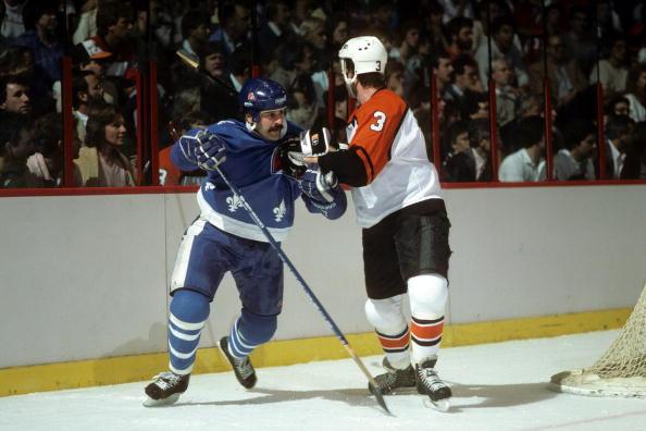 Alain-cote-of-the-quebec-nordiques-skates-against-doug-crossman-of-picture-id91856126