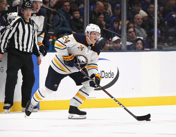 Lawrence Pilut, one of the tremendous fantasy hockey sleeper picks, skates with the puck.