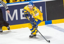 Mario Kempe skates the puck for Sweden during the 2019 World Championship.