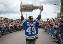 Ivan Barbashev lifts the Stanley Cup during the Blues parade.