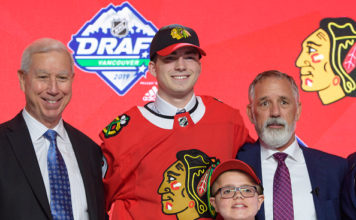 Kirby Dach poses for a picture after being drafted third overall by the Chicago Blackhawks.