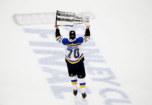 Oskar Sundqvist lifts the Stanley Cup.