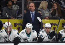 Pete DeBoer looks onward, manning the bench for the 2018-19 San Jose Sharks.