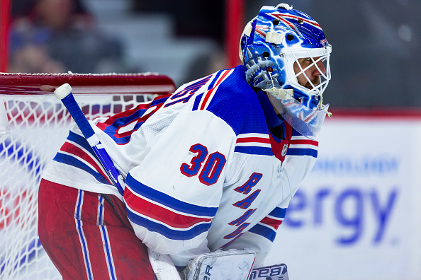 The 2019-20 New York Rangers starting goalie, Henrik Lundqvist, looks onward during a game.