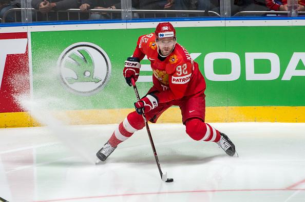 Evgeny Kuznetsov skates with the puck.