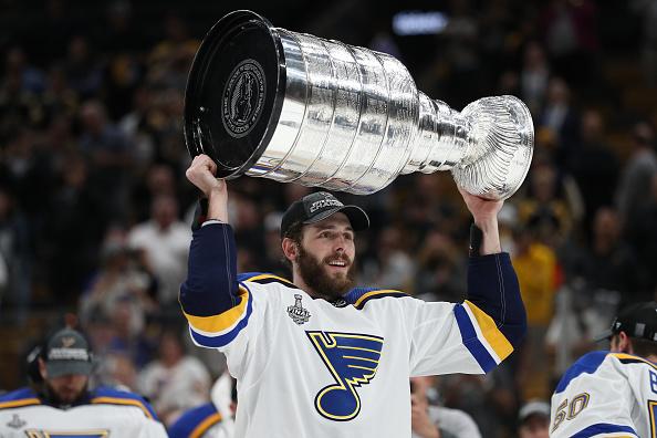 Joel Edmundson lifts the Stanley Cup.