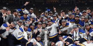 Following the St. Louis Blues biggest game in franchise history, the team takes a photo with the Stanley Cup.