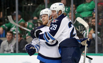Patrik Laine and Nikolaj Ehlers celebrate a goal.