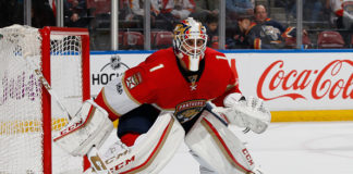 Roberto Luongo faces the puck during a game.