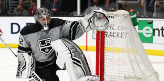 Jonathan Quick saves a shot during a game.