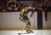 Reggie Leach of the California Seals, one of the first non-traditional hockey markets, skates the puck.