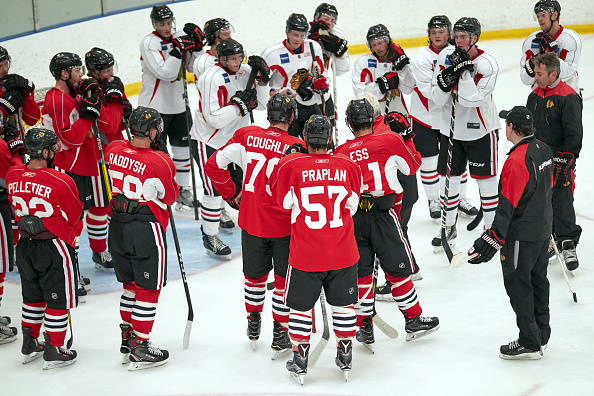 A group gathers to listen to coaches during the Chicago Blackhawks prospect development camp in July.