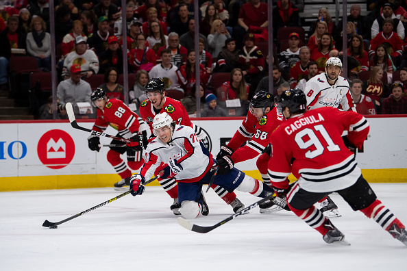 TJ Oshie moves the puck during a Washington Capitals vs Chicago Blackhawks matchup.