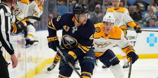 The Buffalo Sabres Conor Sheary plays the puck during game action.
