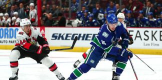Adam Gaudette, one of the rewards of recent Vancouver Canucks moves, skates with the puck in a pre-season game.